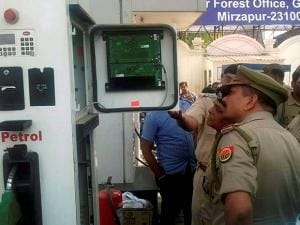 Police officers checking a petrol pump machine in Mirzapur