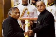President Pranab Mukherjee presents Padma Bhushan to computer scientist Vijay Bhatkar