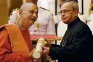 President Pranab Mukherjee presents Padma Bhushan to spiritual guru Swami Satyamitranand