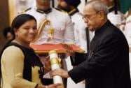 President Pranab Mukherjee presents Padma Shri to hockey player Saba Anjum