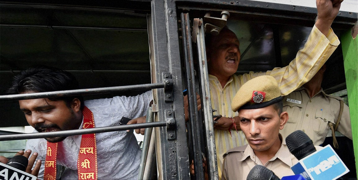 Police, detain, protesters, bus, outside, Pakistan High Commission, New Delhi
