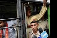 Police detain the protesters in bus outside Pakistan High Commission in New Delhi
