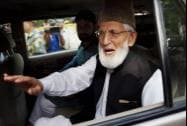 Separatist leader Syed Ali Shah Geelani leaves after a meeting at Pakistan High Commission