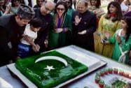 Pakistani High Commissioner to India Abdul Basit cuts the cake to celebrate the 75th Pakistan Day