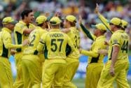 Australian players congratulate Mitchell Starc, second left, after he took the wicket of Pakistan's Sarfaraz Ahmed