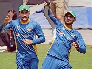 Pakistani cricketer Shoaib Malik with teammate  at a practice session for the upcoming T 20 World Cup