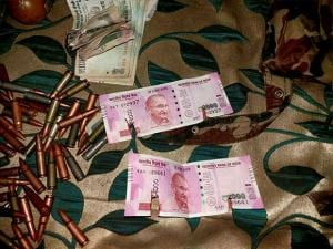 New currency notes of Rs 2000 denomination recovered from militants killed in Bandipora District of North Kashmir