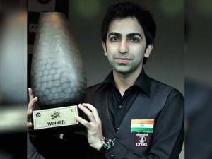 World Champion Cue player Pankaj Advani pose with trophy after winning the Kolkata Open National Invitation Snooker Championship-2017