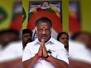 AIADMK leader and former chief minister O Panneerselvam with supporters during their day-long fast