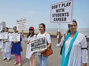 Parents of the students preparing for medical entrance exams, form a human chain to protest against the verdict of Supreme Court's on National Eligibility Entrance Test (NEET) in Mumbai