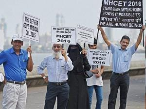 Parents of the students preparing for medical entrance exams, form a human chain to protest against the verdict of Supreme Court's on National Eligibility Entrance Test (NEET) in Mumbai (3)