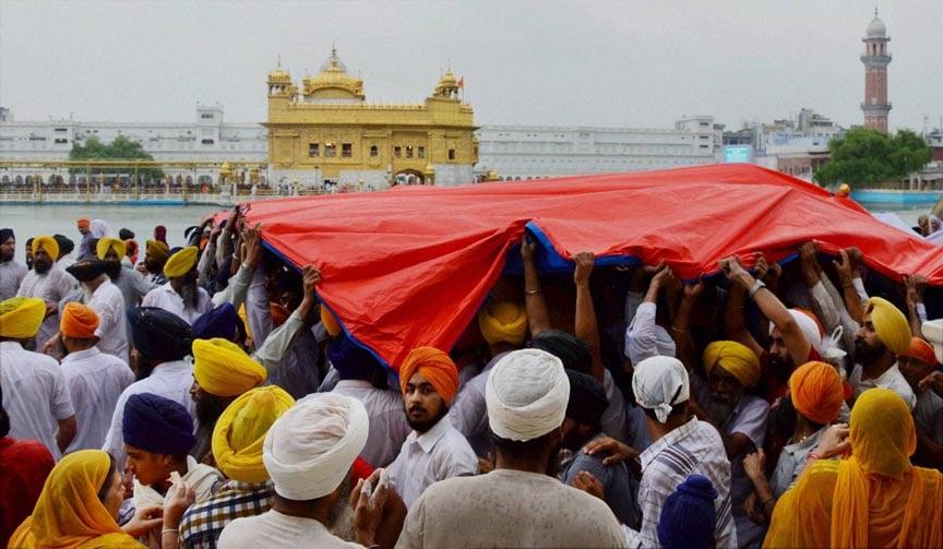 Devotees, protecting, palanquin, installed, Guru Granth Sahib, rain, parikarma, Golden Temple, occasion, Parkash Utsav, Sri, Guru, Granth, Sahib,  Amritsar