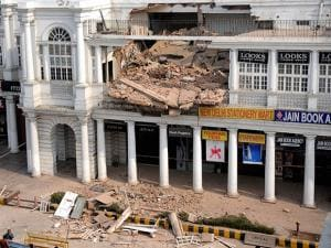 The collapsed section of a building in C-Block area of Connaught Place in New Delhi