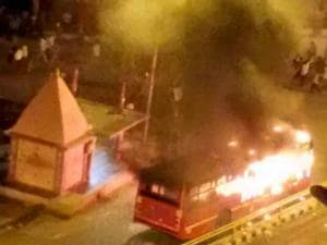 A bus set on fire in Surat