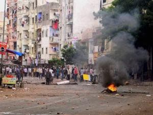 Mob pelting stones at the police during a clash in Ahmedabad