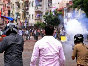 Police fire teargas shells to disperse Patidar community supporters
