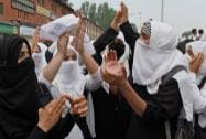 Students shout slogans during a protest against Israel's attacks on Gaza, in Srinagar