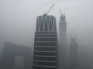 China Central Television (CCTV) headquarters are shrouded by heavy smog in Beijing