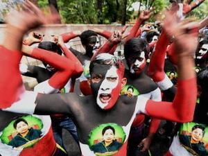 AIADMK cadres, with their bodies painted, celebrate the party's victory in the Assembly polls outside Chief Minister J Jayalalithaa's Poes Garden residence in Chennai