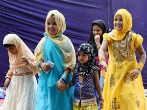 Muslims children arrive to offer Eid al-Fitr prayers at Don Bosco Higher Secondary School