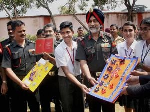 Students handover Diwali greetings cards to Major General KS Nijjar