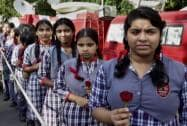 Children stand outside the residence of former President APJ Abdul Kalam