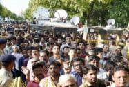 People crowd outside the residence of former President APJ Abdul Kalam