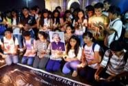 Students participate in a candle march to pay tribute to the former President APJ Abdul Kalam