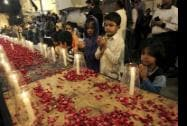 Pakistani children, chant prayers, during a candle light vigil for the victims