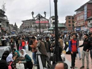People come out of their offices, shops and homes after an earthquake at Lal Chowk
