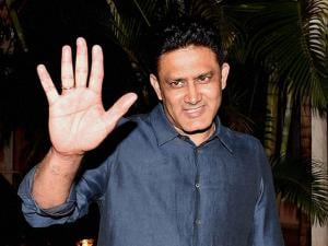 Newly appointed Indian Cricket Team Head Coach Anil Kumble gestures at his residence in Bengaluru
