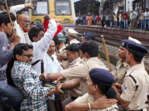 Police remove CPI(M) activists who were protesting at Andheri Railway Station