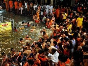 Sadhus and devotees take holy dips during the second Shahi Snan