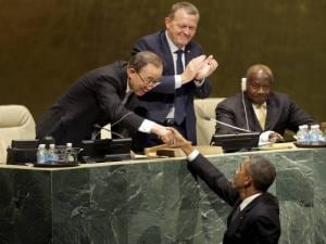 United States President Barack Obama, bottom, greets United Nations Secretary-General Ban Ki-moon