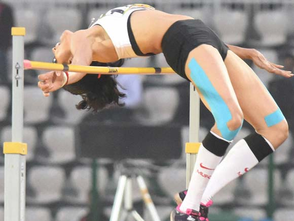 Pictures of the day, Business Standards, Sahana Kumari, High Jump, 12th South Asian Games, Guwahati, Sports