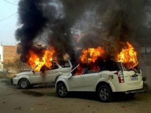 Angry villagers set ablaze vehicles of Samajwadi Party MLAs Prashant Singh and Saeed Ahmed after a clash between two group  during UP Block pramukh polls voting in Bahadurpur village near,in Allahabad