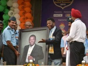 Chief of the Air Staff Air Chief Marshal Arup Raha presenting to Brazilian football legend Pele