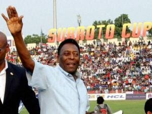 Pele waves to his fans before the start of the Under-17 boys final match of the Subroto Cup