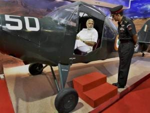 Prime Minister Narendra Modi poses with a small plane