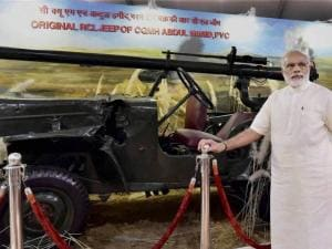 Prime Minister Narendra Modi poses with jeep of with Param Vir Chakra awardee Shaheed Abdul Hameed