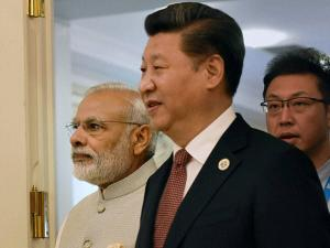 Prime Minister Narendra Modi with Chinese President Xi Jinping arrive for a group photo
