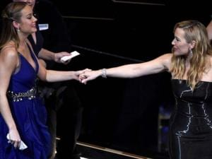 Brie Larson, left, greets Kate Winslet in the audience at the Oscars