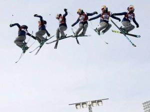 In this multiple exposure, skier Tiril Sjaastad Christiansen, of Norway, jumps during the Big Air at Fenway skiing