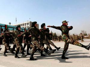 New members of the Afghan National Army march during their graduation ceremony at the Afghan Military Academy in Kabul
