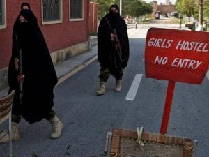 Female Pakistani commandos stand guard outside a hostel for girls at the Bacha Khan University in Charsadda
