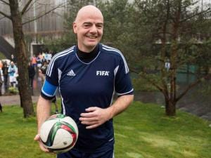 New FIFA President Swiss Gianni Infantino arrives with a ball for a friendly soccer match at the home of FIFA in Zurich, Switzerland