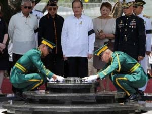 soldiers seal the urn receptacle during the transfer of his remains at the Heroes' Cemetery in suburban Taguig city, east of Manila, Philippines