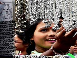 A woman selecting a jewellery at a shop ahead of the Durga Puja festival