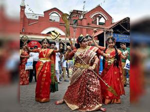 Girls dressed up as Goddess Durga enact the killing of demons during an event