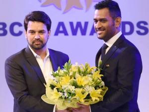 BCCI Secretary Anurag Thakur honours Indian captain M S Dhoni